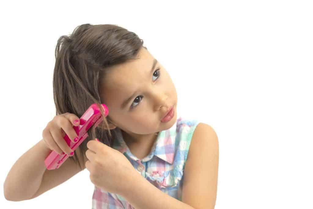little girl with mini flat iron