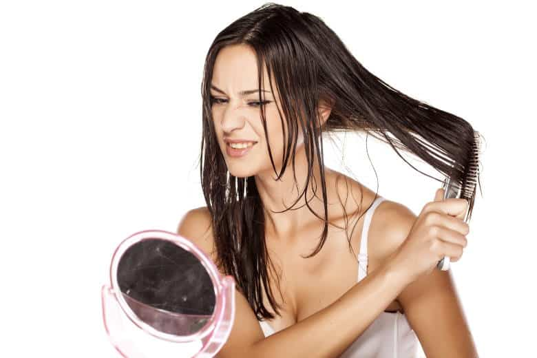 woman brushing wet hair