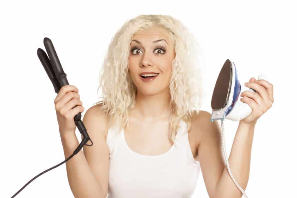 woman holding flat iron and clothes iron_resized