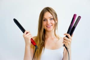 girl with curling wand and flat iron
