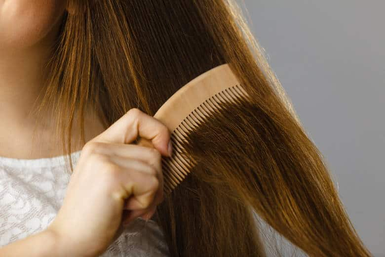 woman combing section of hair