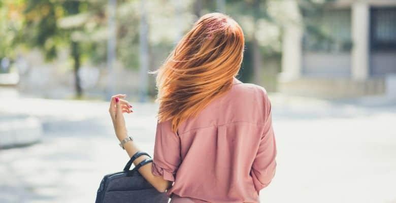 backview of woman with handbag