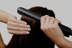 backview of woman using tourmaline flat iron